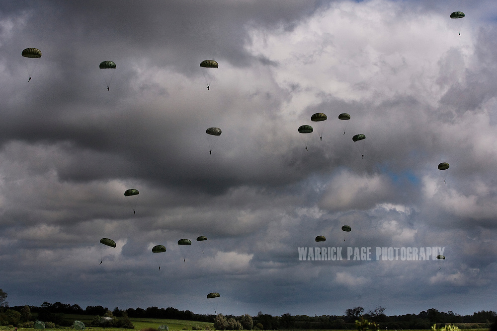 Paratroopers jump near the La Fiere bridge June 3, 2012, in, France. Normandy is the only place in the world that has seen a consistent mass-pilgrimage of war veterans returning to the lands where they fought. No other lands that have born witness to war - including other WWII battlefields - have drawn veterans back in the way that Normandy has. Along with the veterans come thousands of WWII historical enthusiast and family members of passed veterans. Sixty-eight years on the numbers of veterans returning to the beaches and fields where they fought dwindle, as age and time prevail. (Photo by Warrick Page)