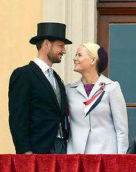 Crown Prince Haakon, and Crown Princess Mette-Marit of Norway, watch the annual Norwegian National Day parade from the balcony of The Royal Palace in Oslo, Norway. May 17, 2013. Photo by: Schneider-Press / i-Images. UK & USA ONLY
