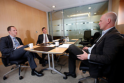 UK ENGLAND LONDON 27SEP10 - Paul Govier (L) and Henry Smith of Maples and Calder law firm during interview with SPIEGEL reporte Uwe Buse (R) at the firm's offices in the city of London...jre/Photo by Jiri Rezac..© Jiri Rezac 2010