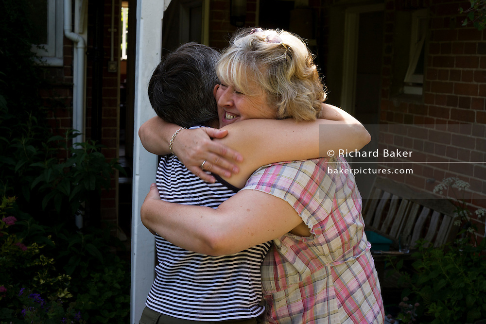 Friends say farewell after weekend together at the Rivendell Buddhist Retreat Centre, East Sussex, England.