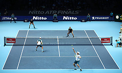 Mike and Bob Bryan in action against during their doubles match against Bruno Soares (top right) and Jamie Murray during day two of the NITTO ATP World Tour Finals at the O2 Arena, London.