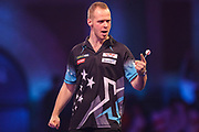 Max Hopp wins the first set against Benito van de Pas during the PDC William Hill World Darts Championship at Alexandra Palace, London, United Kingdom on 20 December 2019.