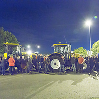 NORTHWICH, UK:<br /> Farmers protesting at the prices they are paid for milk, blockade the entrance to a major distribution depot of the supermarket giant Morrisons, causing major disruption to the supermarket's supply chain on Monday evening, 24th August 2015.<br /> PHOTOGRAPH BY TERRY KANE / BARCROFT MEDIA LTD<br /> <br /> UK Office, London.<br /> T: +44 845 370 2233<br /> E: pictures@barcroftmedia.com<br /> W: www.barcroftmedia.com<br /> <br /> Australasian &amp; Pacific Rim Office, Melbourne.<br /> E: info@barcroftpacific.com<br /> T: +613 9510 3188 or +613 9510 0688<br /> W: www.barcroftpacific.com<br /> <br /> Indian Office, Delhi.<br /> T: +91 997 1133 889<br /> W: www.barcroftindia.com