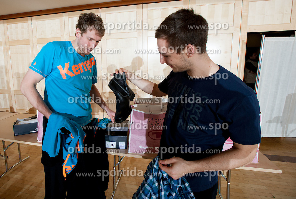 David Miklavcic and Gasper Marguc of Slovenian Handball Men National Team when they get new clothes of Sportina Group for the EHF European Championship EURO 2012 in Serbia, on January 11, 2011, in Zrece, Slovenia. (Photo by Vid Ponikvar / Sportida)