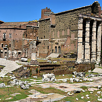 Temple Mars Ultor at Forum of Augustus in Rome, Italy<br /> Julius Caesar was assassinated in 44 BC. Gaius Octavius Thurinus, his adopted son, vowed to avenge his death. He, along with Mark Anthony, launched the civil war called the Battle of Philippi. After their victory, a triumvirate of leaders divided the spoils (Roman Republic). This arrangement was short lived. By 27 BC, Octavius consolidated power, formed the new Roman Empire and became Emperor Augustus, a role he held for 40 years. To celebrate his success, he commissioned the Forum of Augustus (located next to Trajan's Market). The centerpiece was the Temple of Mars Ultor (Mars the Avenger). Now only four of the Carrara marble columns remain upright. The forum was also filled with statues. The largest was of Augustus. Over 100 more portrayed the likeness of men who helped form the new empire. Other carvings showed members of the Julio-Claudian dynasty. This family produced five emperors from 27 BC until the death of Nero in 68 AD.