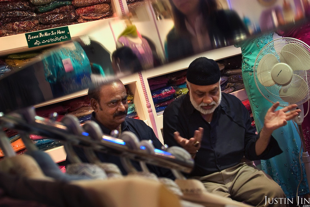 Pakistani-British man Azmat Begg (left), 60, talks to a long-time friend in a clothes store in Birmingham city, central England. ....The former banker is the father of Moazzam Begg, 36, held for three years in the U.S. prison camp at Guantanamo Bay. Begg was released without charge in January 2005. ....Washington alleges Moazzam Begg - among hundreds it held without trial after the Sept. 11, 2001, attacks - was trained in explosives at an al-Qaeda camp. Begg was arrested in Pakistan, after visiting Afghanistan.....But the father and his lawyer say Begg, who ran a religious bookshop in Birmingham, was innocent and was scarred after being tortured while in U.S. custody...The elder Begg is one of the first immigrants to arrive from Pakistan. He came to the UK in the 1950s to work...