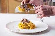 International White Truffle Fair, Alba, Piemonte - TAGLIOLINI (TAJARIN) CON TARTUFO BIANCO D'ALBA - local dish with fresh tartufo bianco (white truffle) prepared at Ristorante Da Francesco, Cherasco, near Alba in Le Langhe area of Piedmont