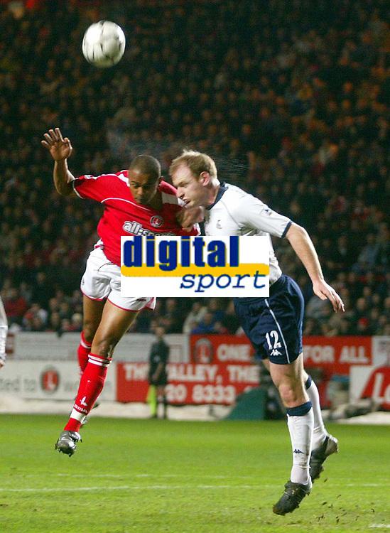 Photo: Scott Heavey.<br /> Charlton Athletic v Tottenham Hotspur. FA Barclaycard Premiership. 11/02/2004.<br /> Gary Doherty (R) beats Sean Bartlett in the air