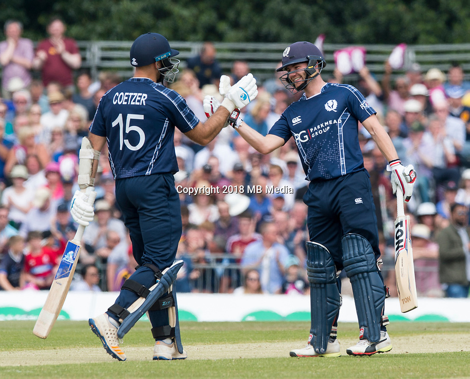 EDINBURGH, SCOTLAND - JUNE 10: Scotland openers, Kyle Coetzer and Matthew Cross, celebrate reaching 100 in the first innings of the one-off ODI at the Grange Cricket Club on June 10, 2018 in Edinburgh, Scotland. (Photo by MB Media/Getty Images)