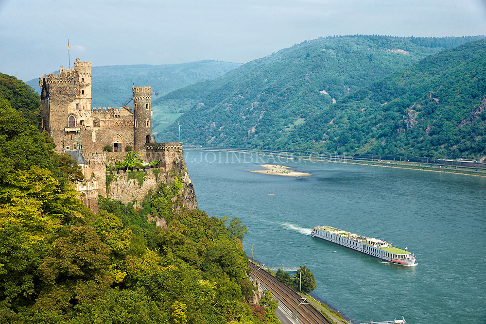 View of the Rheinstein (Burg) Castle, Forest, and a Rhine River Cruise, Trechtingshausen, Germany.