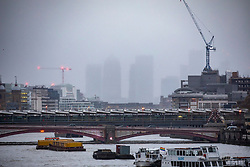 © Licensed to London News Pictures. 13/01/2020. London, UK. Misty rain across the City this evening as London braces for high winds and heavy squally rain during this evening's rush hour. Storm Brendan is forecast to blow in towards the South East with winds expected to peak up to 45mph. Photo credit: Alex Lentati/LNP