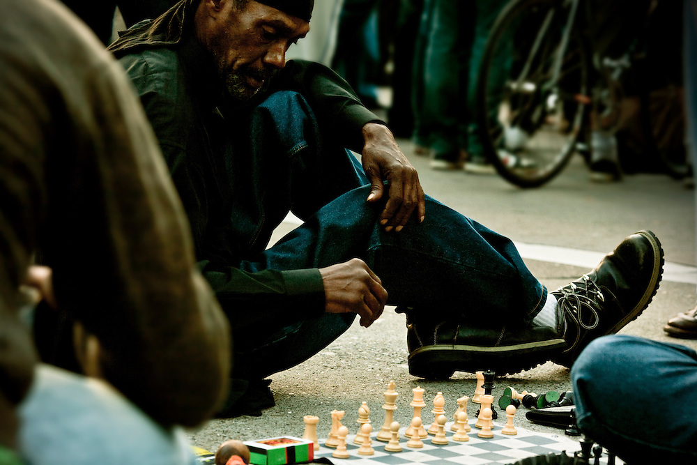 Chess game on Broadway during Oscar Grant demonstration in Oakland, CA.  Copyright 2010 Reid McNally.