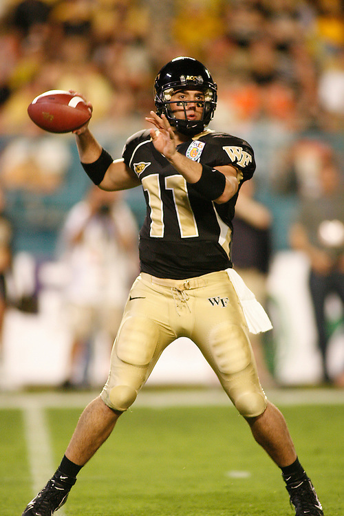 Wake Forest University quarterback Riley Skinner drops back to pass during the Louisville Cardinals 24-13 victory over the Wake Forest Demon Deacons at the 2007 Orange Bowl Game on January 2, 2007 at the Dolphin Stadium in Miami, Florida.