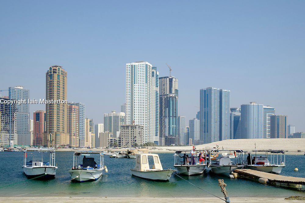 Daytime skyline view of  modern high-rise apartment buildings  in Sharjah United Arab Emirates
