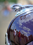TULLYTOWN, PA - AUGUST 24: Spectators are reflected in a 1937 Chevy body at the Tullytown Fire Company's annual car and motorcycle show August 24, 2014 in Tullytown, Pennsylvania. The show is held to raise money to buy firefighting equipment. (Photo by William Thomas Cain/Cain Images)