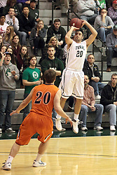 01 March 2014:  Brayden Teuscher stands too far away to defend a three point shot by Pat Sodemann during an NCAA mens division 3 CCIW  Championship basketball game between the Wheaton Thunder and the Illinois Wesleyan Titans in Shirk Center, Bloomington IL