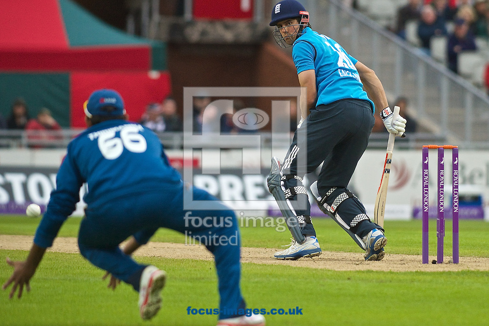 Alastair Cook of England looks on anxiously as Lahiru Thirimanne of Sri Lanka almost makes the catch during the Royal London One Day Series match at Old Trafford Cricket Ground, Stretford<br /> Picture by Ian Wadkins/Focus Images Ltd +44 7877 568959<br /> 28/05/2014