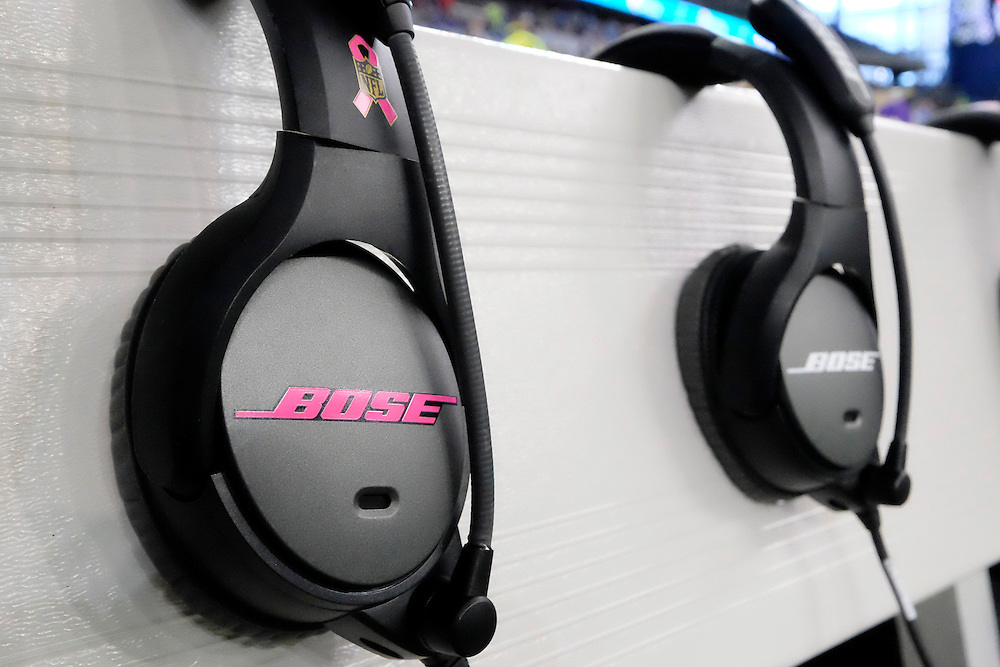 A pink ribbon for Breast Cancer Awareness is seen on a set of Bose headphones are seen on the bench during the first half of an NFL football game between the Detroit Lions and the Arizona Cardinals, Sunday, Oct. 11, 2015. (AP Photo/Rick Osentoski)