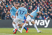 Manchester City midfielder Ilkay Gundogan (8) fouls Crystal Palace midfielder James McArthur (18) during the Premier League match between Crystal Palace and Manchester City at Selhurst Park, London, England on 14 April 2019.