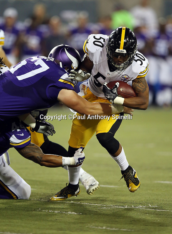 Pittsburgh Steelers inside linebacker Ryan Shazier (50) runs with the ball after intercepting a pass later ruled an incompletion during the 2015 NFL Pro Football Hall of Fame preseason football game against the Minnesota Vikings on Sunday, Aug. 9, 2015 in Canton, Ohio. The Vikings won the game 14-3. (©Paul Anthony Spinelli)