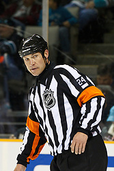 February 1, 2011; San Jose, CA, USA; NHL referee Stephen Walkom (24) before a face off between the San Jose Sharks and the Phoenix Coyotes during the first period at HP Pavilion. San Jose defeated Phoenix 5-3. Mandatory Credit: Jason O. Watson / US PRESSWIRE