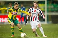 18-12-2010 ADO DEN HAAG - WILLEM II<br /> Jens Toornstra in duel met Jan-Arie van der Heijden (R)<br /> foto: Geert van Erven