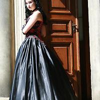 Young woman wearing regency dress standing at a door