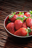Strawbwrry on wooden background - close-up