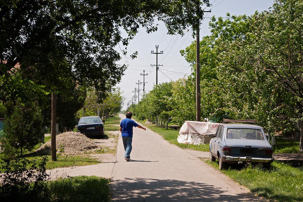 A man walks along the street where Ratko Mladic was captured in the village of Lazarevo, Serbia ...Matt Lutton for The International Herald Tribune..Capture of Ratko Mladic. Lazarevo, Serbia. May 27, 2011.