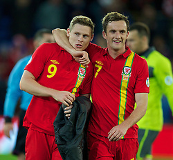 11.10.2013, City Stadion, Cardiff, WAL, FIFA WM Qualifikation, Wales vs Mazedonien, Gruppe A, im Bild Wales' goalscorer Simon Church and Andy King after the 1-0 victory over Macedonia during the FIFA World Cup Qualifier Group A Match between Wales and Macedonia at the City Stadium, Cardiff, Wales on 2013/10/11. EXPA Pictures © 2013, PhotoCredit: EXPA/ Propagandaphoto/ David Rawcliffe<br /> <br /> ***** ATTENTION - OUT OF ENG, GBR, UK *****