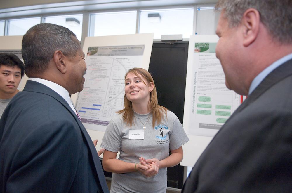 18208Student Reasearch & Creativity Activity Fair Spring 2007..President McDavis & Interim Vp For Research, James Rankin..Talk to Sadie Roth