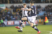 Andy Cannon's shot is blocked by Jason Shackell during the The FA Cup 4th round match between Millwall and Rochdale at The Den, London, England on 27 January 2018. Photo by Daniel Youngs.