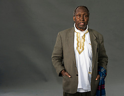 "Pictured: Ngũgĩ wa Thiong'o<br /> <br /> Ngũgĩ wa Thiong'o (Gikuyu pronunciation: [ᵑɡoɣe wá ðiɔŋɔ]; born 5 January 1938)[1] is a Kenyan writer, formerly working in English and now working in Gikuyu. His work includes novels, plays, short stories, and essays, ranging from literary and social criticism to children's literature. He is the founder and editor of the Gikuyu-language journal Mũtĩiri.<br /> <br /> In 1977, Ngũgĩ embarked upon a novel form of theatre in his native Kenya that sought to liberate the theatrical process from what he held to be ""the general bourgeois education system"", by encouraging spontaneity and audience participation in the performances.[2] His project sought to ""demystify"" the theatrical process, and to avoid the ""process of alienation [that] produces a gallery of active stars and an undifferentiated mass of grateful admirers"" which, according to Ngũgĩ, encourages passivity in ""ordinary people"". Although Ngaahika Ndeenda was a commercial success, it was shut down by the authoritarian Kenyan regime six weeks after its opening.<br /> <br /> Ngũgĩ was subsequently imprisoned for over a year. Adopted as an Amnesty International prisoner of conscience, the artist was released from prison, and fled Kenya. In the United States, he taught at Yale University for some years, and has since also taught at New York University, with a dual professorship in Comparative Literature and Performance Studies, and at the University of California, Irvine. Ngũgĩ has frequently been regarded as a likely candidate for the Nobel Prize in Literature. His son is the author Mũkoma wa Ngũgĩ.<br /> <br /> Ger Harley 