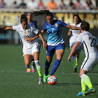 ORLANDO, FL - OCTOBER 25: Beatriz #7 of Brazil and Carli Lloyd #10 of USWNT fight for the ball during a women's international friendly soccer match between Brazil and the United States at the Orlando Citrus Bowl on October 25, 2015 in Orlando, Florida. The United States won the match 3-1. (Photo by Alex Menendez/Getty Images) *** Local Caption *** Beatriz; Carli Lloyd