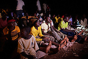 Youngsters are watching television in a public ground in Bagega, pop. 9000, a large village affected by lead poisoning due to the unsafe techniques employed for extracting gold, in Zamfara State, Nigeria. It is mainly caused by ingestion and breathing of lead particles released in the steps to isolate the gold from other metals. This type of lead is soluble in stomach acid and children under-5 are most affected, as they tend to ingest more through their hands by touching the ground, and are developing symptoms often leading to death or serious disabilities.