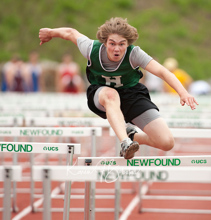 Aaron Beckwith of Hopkinton competes in the 110 meter hurdles during NHIAA DIvision III State Track Championships Saturday at Newfound High School.  (Karen Bobotas/for the Concord Monitor)