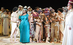 © Licensed to London News Pictures. 22/02/2012. London, England. Indra Thomas as Aida (turqouise dress). New production of Giuseppe Verdi's opera Aida staged in the round of the Royal Albert Hall with Indra Thomas as Aida, Mark Heller as Radames, Tiziana Carraro as Amneris, David Kempster as Amonasro and Stanislav Shvets as Ramfis. Photo credit: Bettina Strenske/LNP