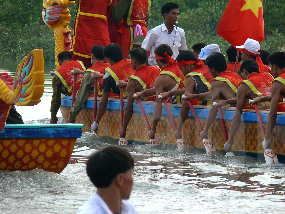 "Dragon boat race in Quan Lan island. A dragon boat (also dragonboat) is a very long and narrow canoe-style human-powered boat. It is now used in the team paddling sport of dragon boat racing which originated in China over 2000 years ago. While competition has taken place annually for more than 20 centuries as part of folk ritual, it emerged in modern times as an international ""sport"" in Hong Kong in 1976. Like running, horse racing and marksmanship, the racing of dragon boats is among mankind's oldest organized competitions."