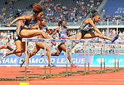 Kendra Harrison (USA), right, defeats Brianna Rollins (USA) to win the women's 100m hurdles, 12.46 to 12.57, during IAAF Birmingham Diamond League meeting at Alexander Stadium on Sunday, June 5, 2016, in Birmingham, United Kingdom. Photo by Jiro Mochizuki