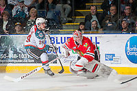 KELOWNA, CANADA - APRIL 25: Tyson Baillie #24 of the Kelowna Rockets makes a pass as Corbin Boes #30 of the Portland Winterhawks tries to skate back to the net on April 25, 2014 during Game 5 of the third round of WHL Playoffs at Prospera Place in Kelowna, British Columbia, Canada. The Portland Winterhawks won 7 - 3 and took the Western Conference Championship for the fourth year in a row earning them a place in the WHL final.  (Photo by Marissa Baecker/Getty Images)  *** Local Caption *** Tyson Baillie; Corbin Boes;