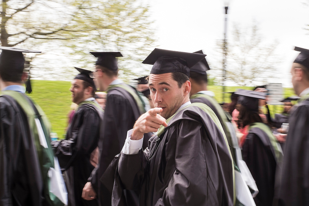 A College of Business student makes his way toward the Convocation Center before the start of Ohio University's Graduate Commencement ceremony on Friday, May 1, 2015.  Photo by Ohio University  /  Rob Hardin