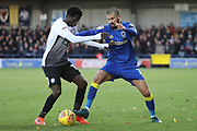 AFC Wimbledon defender George Francomb (7) battles for possession with Peterborough United midfielder Leo Da Silva Lopes (18) during the EFL Sky Bet League 1 match between AFC Wimbledon and Peterborough United at the Cherry Red Records Stadium, Kingston, England on 12 November 2017. Photo by Matthew Redman.