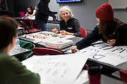 MADISON, WI – MARCH 27: Mary Sanderson, center, designs a protest sign at the UW South Madison Partnership space in advance of Presidential candidate Donald Trump's visit to Janesville, Wisconsin.