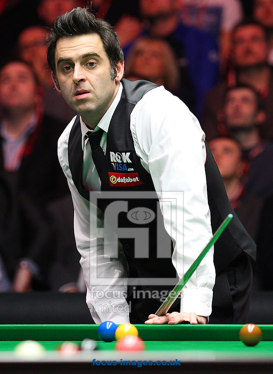 Picture by Paul Terry/Focus Images Ltd +44 7545 642257<br /> 19/01/2014<br /> Ronnie O'Sullivan looks on after playing a shot during The Masters final at Alexandra Palace, London.