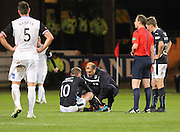 Dundee physio Niam Mohammed treates Kevin Thomson  - Dundee v Inverness Caledonian Thistle, SPFL Premiership at Dens Park <br /> <br />  - &copy; David Young - www.davidyoungphoto.co.uk - email: davidyoungphoto@gmail.com