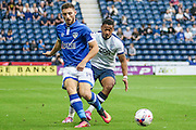 Preston North End Midifelder Chris Humphries and Oldham Athletic Forward, Jake Cassidy (14) during the EFL Cup match between Preston North End and Oldham Athletic at Deepdale, Preston, England on 23 August 2016. Photo by Pete Burns.