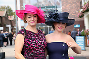 Two elegant and well dressed ladies arrive prior to the October Finale meeting at York Racecourse, York, United Kingdom on 13 October 2018. Pic Mick Atkins