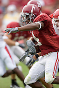 Alabama Crimson Tide wide receiver Tyrone Prothro gets tackled during a 24 to 13 win over the Arkansas Razorbacks on September 24, 2005 at Bryant-Denny Stadium in Tuscaloosa, Alabama..Mandatory Credit: Wesley Hitt/Icon SMI