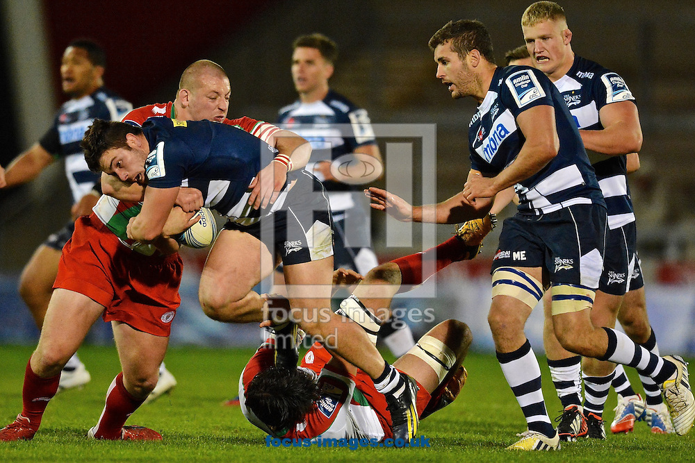 Picture by Ian Wadkins/Focus Images Ltd +44 7877 568959<br /> 10/10/2013<br /> Marc Jones of Sale Sharks is challenged during the Amlin Challenge Cup match at AJ Bell Stadium, Eccles.
