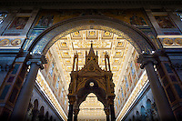 """Baldacchino at the Basilica of St. Paul outside the Walls...The Papal Basilica of St Paul Outside the Walls """"Basilica Papale di San Paolo fuori le Mura"""" is one of four churches that are the great ancient major basilicas or papal basilicas of Rome.  The basilica was founded by the Roman Emperor Constantine I over the burial place of Saint Paul, where it was said that, after the Apostle's execution, his followers erected a memorial, called a cella memoriae. After a fire in 1823 this mosaic facade of the Basilica was the only piece of architecture to survive.  The Basilica was re-created in exact replica in 1840."""